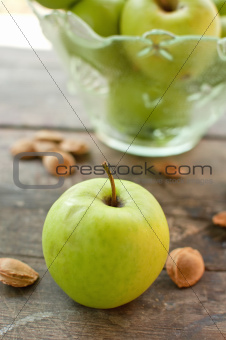 Green apples on table
