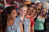 Smiling Teen Girls in Line