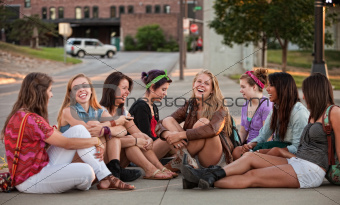 Eight Pretty Girls Sitting Outdoors