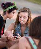 Cute Teen Girls Using Phone