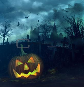 Halloween pumpkin in spooky graveyard