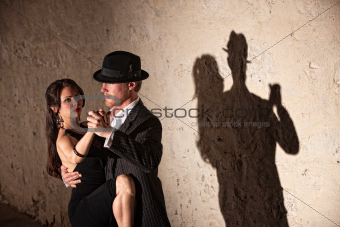 Tango Dancers Under Spotlight