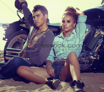 Travel destination. Young couple relaxing on beach