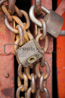 old rusty metal padlocks on chains