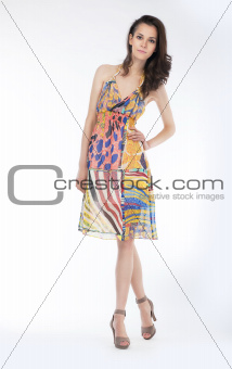 Sensual young woman in trendy dress posing