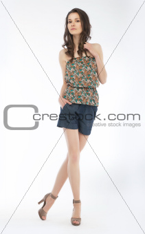 Young lovely slim woman in blouse and shorts