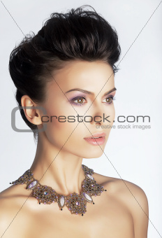 Fashionable elegant lady with jewels