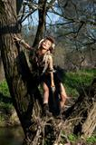 Rain forest scenery. Nature. Tribe style. Fashion woman in wood