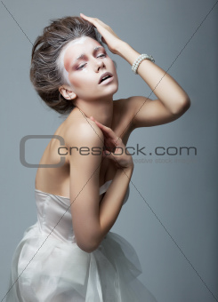 Fashionable emotional artistic female in dramatic pose