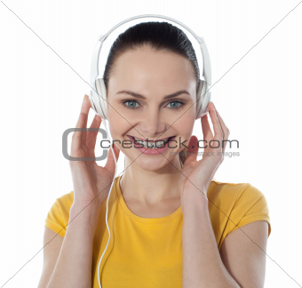 Pretty young female enjoying music