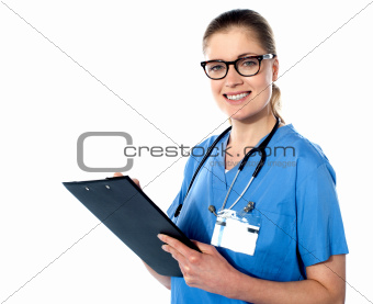 Friendly female doctor with a clipboard