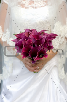 bride and bouquet of lilies
