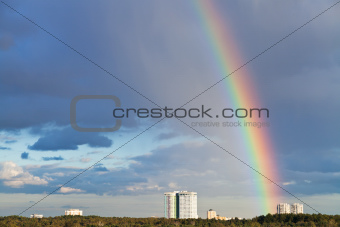 urban panorama with rainbow