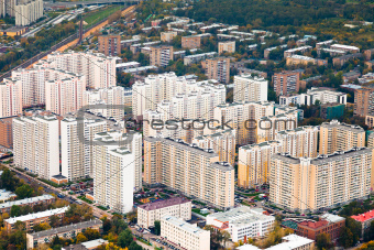 block of modern houses in autumn day