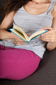 reading lying on sofa