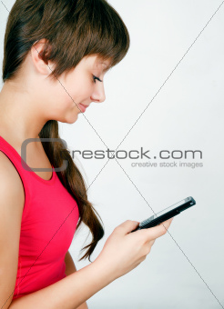 teen girl with a mobile phone