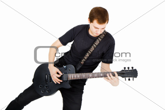 Musician with a black electric guitar