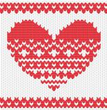 Knitted vector heart on seamless background