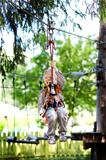 little boy ziplining