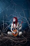 Pale forest spirit girl with musical instrument