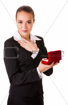 Admired business woman with open jewel box
