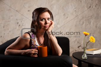 Serious Woman Sitting with Mug