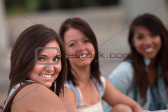 Three Cute Teen Girls Sitting