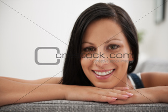 Portrait of girl laying on sofa in living room