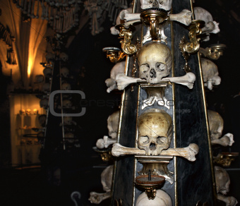 Candlestick with human skulls and bones