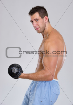 Strong sports man workout biceps with dumbbell