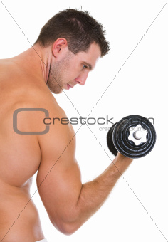 Male athlete with strong biceps rising dumbbell