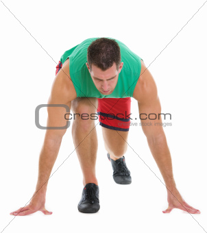 Fitness runner in ready to start position
