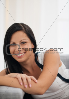 Portrait of smiling young woman in living room