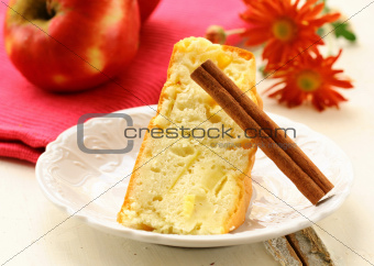 apple pie with cinnamon stick on a white plate