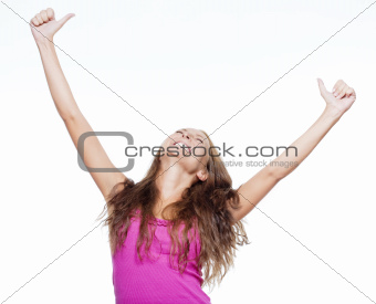 excited young girl showing both thumbs up screming - isolated on white