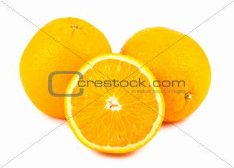 Sliced and whole orange fruits