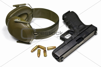 Pistol, ear protection and ammunition isolated on white