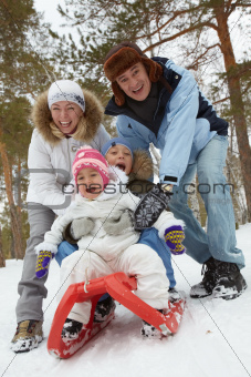 Family on sledge