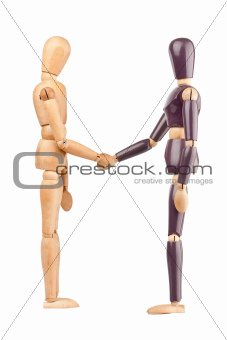 Wooden dummies shaking hands