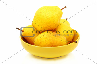 Four ripe pears in the yellow bowl.