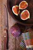 fresh figs in a plate, old knife and towel