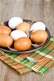 eggs in a plate, towel and feathers