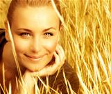 Beautiful female on wheat field