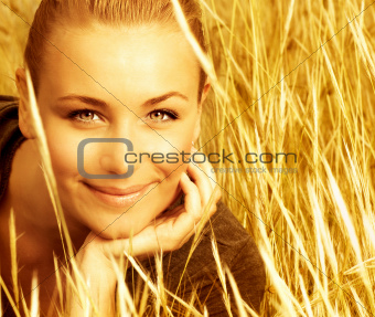 Beautiful female on wheat field