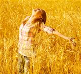 Girl on autumn wheat field