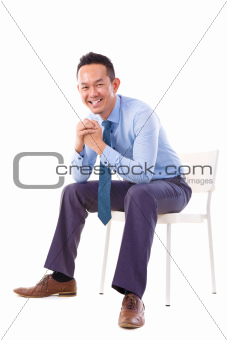 Asian businessman sitting on a chair