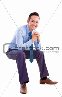 Asian man sitting on transparent chair