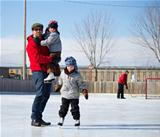 Happy family at the skating rink