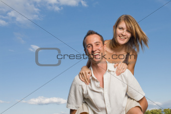 Young lovers piggy back