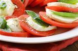 Italian salad with mozzarella cheese and tomato